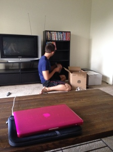 Nathan setting up our entertainment system so I could watch my show Monday night :)