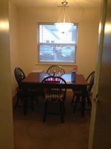 The view of the dining room from the kitchen.